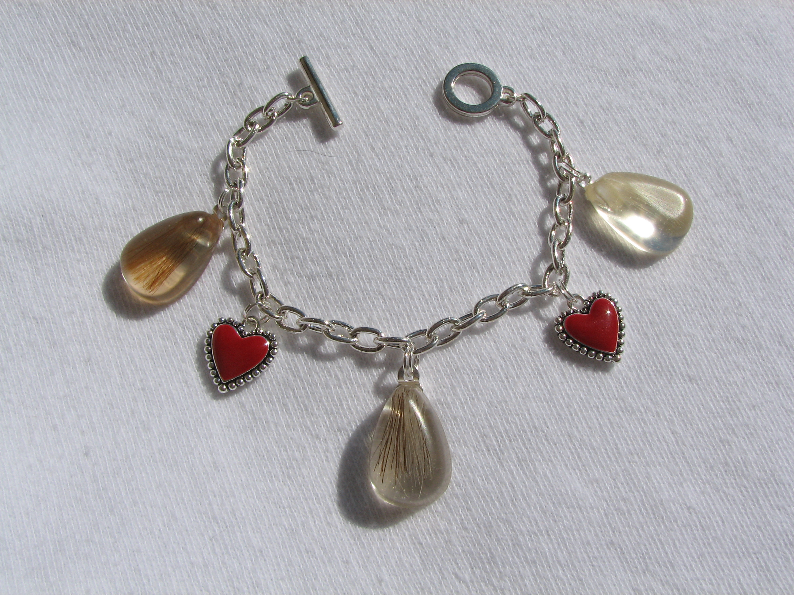 charm bracelet with 3 pendants